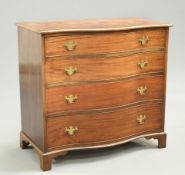 A GEORGE III STYLE MAHOGANY SERPENTINE CHEST OF DRAWERS