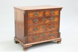 A GEORGE III RED WALNUT CHEST OF DRAWERS