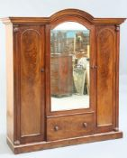 A VICTORIAN MAHOGANY THREE-DOOR WARDROBE