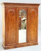 A MID VICTORIAN MAHOGANY THREE-DOOR WARDROBE