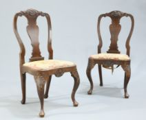 A PAIR OF GEORGE I STYLE CARVED OAK SIDE CHAIRS