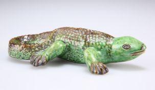 A GREEN-GLAZED POTTERY MODEL OF A LIZARD