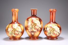 A GARNITURE OF THREE POTTERY VASES