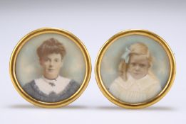 A PAIR OF EARLY 20TH CENTURY PORTRAIT MINIATURES ON IVORY