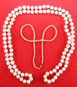 A CONTINUOUS CULTURED PEARL NECKLACE AND A SIMULATED PEARL NECKLACE