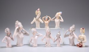 TEN VARIOUS EARLY 20TH CENTURY CONTINENTAL PORCELAIN PIN CUSHION DOLLS