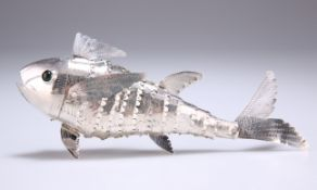 AN ARTICULATED SILVER METAL MODEL OF A FISH