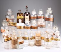 A QUANTITY OF VICTORIAN AND LATER GLASS APOTHECARY BOTTLES