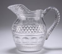 AN EARLY 19TH CENTURY CUT-GLASS WATER JUG