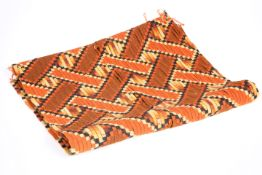 A LENGTH OF ORANGE/BROWN WOVEN FABRIC