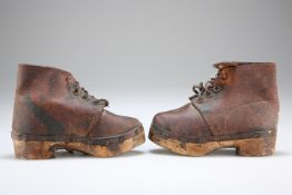 A PAIR OF CHILD'S LEATHER CLOGS