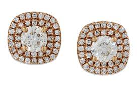 A PAIR OF 18 CARAT ROSE GOLD DIAMOND CLUSTER STUD EARRINGS