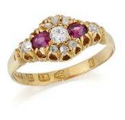 A VICTORIAN 18 CARAT GOLD RUBY AND DIAMOND CLUSTER RING