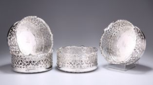 AN EXCEPTIONAL SET OF FOUR EARLY VICTORIAN SILVER COASTERS