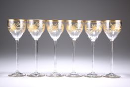 A SET OF SIX VENETIAN GILDED GLASS WINES, POSSIBLYSALVIATI, cut and gilded with roses, fronds and a
