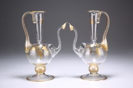 A PAIR OF GILDED EWERS