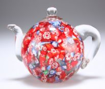 AN UNUSUAL GLASS PAPERWEIGHT IN THE FORM OF A TEAPOT