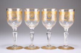 A SET OF FOUR GILDED WINE GLASSES