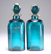 A PAIR OF GEORGIAN TURQUOISE DECANTERS