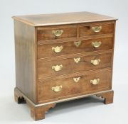 A GEORGE III STYLE CROSSBANDED MAHOGANY CHEST OF DRAWERS