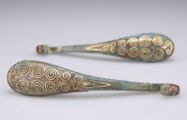 A PAIR OF GOLD DECORATED BRONZE GARMENT HOOKS