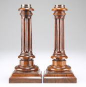 A PAIR OF GEORGE III ROSEWOOD CANDLESTICKS