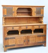 AN ARTS AND CRAFTS OAK SIDEBOARD, IN THE MANNER OF LIBERTY & CO