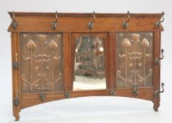 SHAPLAND AND PETTER AN ARTS AND CRAFTS OAK AND COPPER MIRROR BACKED HAT AND COAT RACK