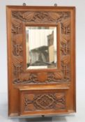 GIGGLESWICK SCHOOL AN ARTS AND CRAFTS CARVED OAK HALL MIRROR CIRCA 1905