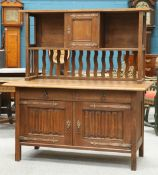AN ARTS AND CRAFTS OAK SIDEBOARD