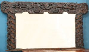 A LARGE ARTS AND CRAFTS CELTIC REVIVAL OAK OVERMANTEL MIRROR