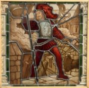 AN ARTS AND CRAFTS STAINED AND LEADED GLASS WINDOW