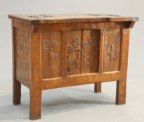 AN UNUSUAL ARTS AND CRAFTS OAK 'HUNTING' CABINET