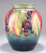 """WALTER MOORCROFT, A LARGE """"LEAF AND BERRY"""" PATTERN POTTERY VASE"""