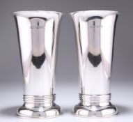 A PAIR OF ARTS AND CRAFTS SILVER VASES, by Ollivant & Botsford