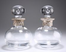 A PAIR OF 20TH CENTURY BULBOUS GLASS DECANTERS