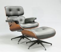 AN EAMES STYLE LEATHER AND BENTWOOD SWIVEL CHAIR AND FOOTSTOOL