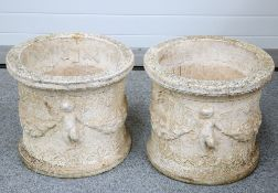 A PAIR OF COMPOSITE STONE PLANTERS