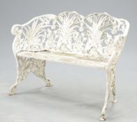 A WHITE PAINTED METAL GARDEN BENCH