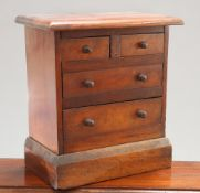 A VICTORIAN MAHOGANY MINIATURE CHEST OF DRAWERS