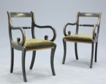 A PAIR OF REGENCY STYLE PAINTED AND GILDED OPEN ARMCHAIRS