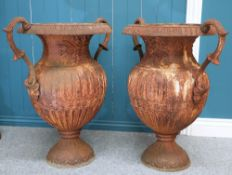 A LARGE PAIR OF CAST IRON TWO-HANDLED URNS