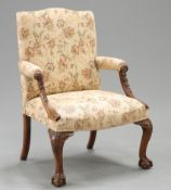 A CHIPPENDALE STYLE MAHOGANY GAINSBOROUGH CHAIR