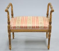 AN ADAM STYLE GILTWOOD AND UPHOLSTERED STOOL
