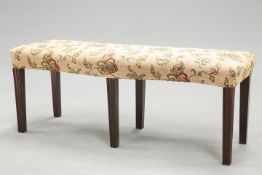 A GROUP OF THREE COUNTRY HOUSE MAHOGANY AND UPHOLSTERED WINDOW SEAT STOOLS