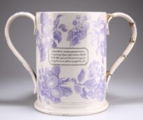 A LARGE TRANSFER PRINTED POTTERY TWO HANDLED LOVING CUP