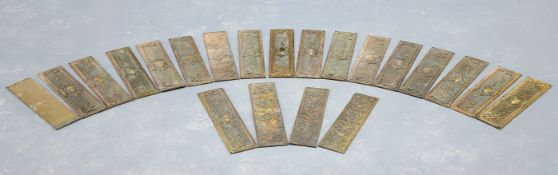 A COLLECTION OF BRASS DOOR PLATES
