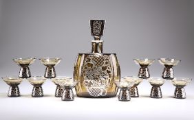 A SILVER MOUNTED AMBER GLASS LIQUEUR SET, FOR 12 PERSONS, CIRCA 1930s