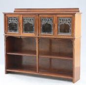 AN ART NOUVEAU MAHOGANY AND LEADED GLASS BOOKCASE BY KENDAL MILNE & CO, MANCHESTER