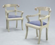 A PAIR OF SILVERED METAL ARMCHAIRS IN THE ANGLO-INDIAN STYLE